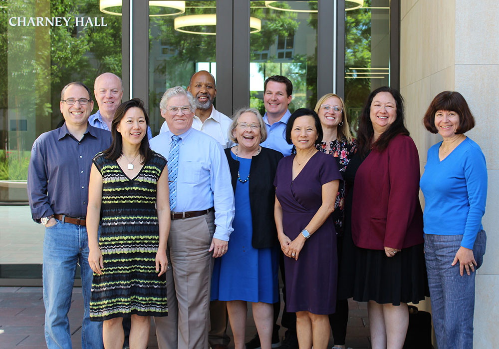 photo of Santa Clara Law High Tech Law faculty in front of Charney Hall (law school building)